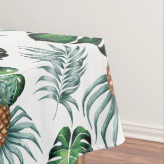 Tropical watercolor pineapple painting on white tablecloth