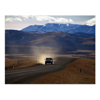 Truck on dirt road in western Canada Post Card