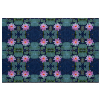 Truly beautiful pink water lilies on blue fabric
