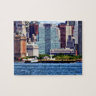 Tugboat Pushing Barge Near Manhattan Skyline Puzzle