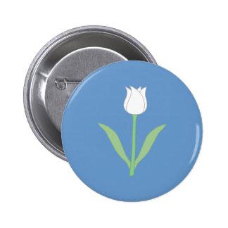 Tulipe blanche sur le bleu badges