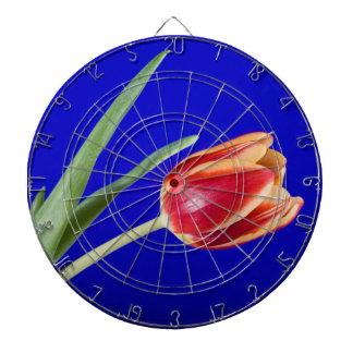 Tulipe sur l'arrière - plan bleu jeu de fléchettes