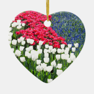 Tulips field in red and white with blue hyacinths ceramic heart ornament