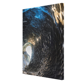 Tunnel thorugh an ice cave, iceland canvas print