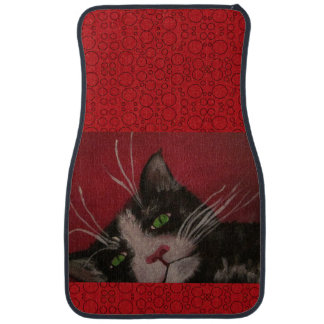 tuxedo cat on red car mat