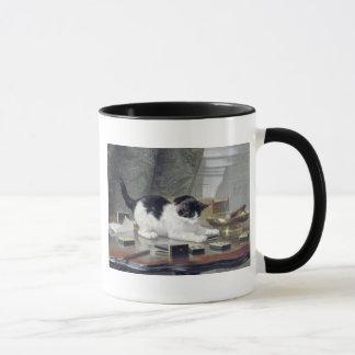 Tuxedo kitten playing dominoes painting gift mug