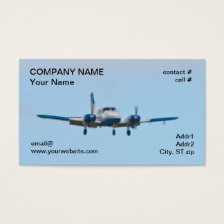 Twin airplane on landing approach business card