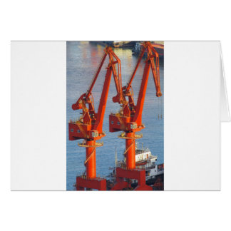 twin construction cranes look like birds dinosaurs card