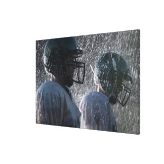 Two American football players in rain, side view Gallery Wrapped Canvas