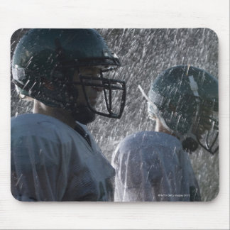 Two American football players in rain, side view Mouse Pad