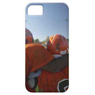 Two American football players looking at playing iPhone 5 Cases