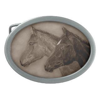 Two baby horses black foal chestnut foal portrait oval belt buckles