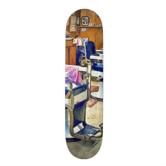 Two Barber Chairs With Pink Striped Barber Capes Skate Board Deck