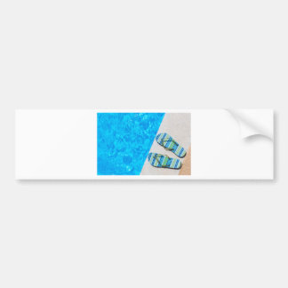 Two bathing slippers on edge of swimming pool bumper sticker