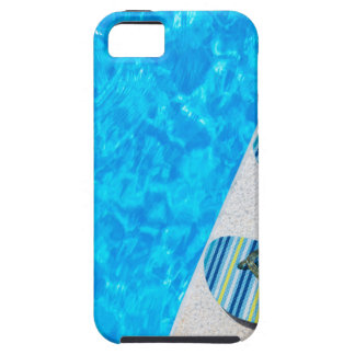 Two bathing slippers on edge of swimming pool iPhone 5 cases
