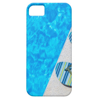 Two bathing slippers on edge of swimming pool iPhone 5 covers