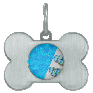 Two bathing slippers on edge of swimming pool pet ID tag
