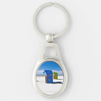 Two beach chairs at the North Sea Silver-Colored Oval Keychain
