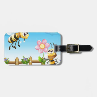 Two bees inside the wooden fence luggage tag
