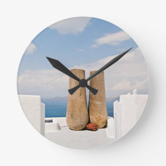 Two big pots on Santorini island Round Clock