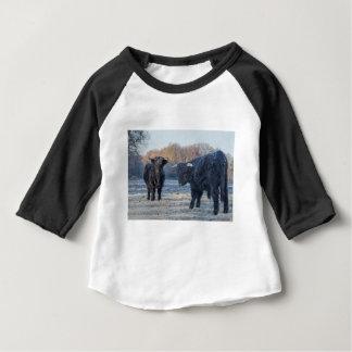 Two black scottish highlanders in frozen meadow baby T-Shirt
