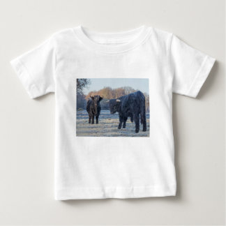 Two black scottish highlanders in frozen meadow baby T-Shirt