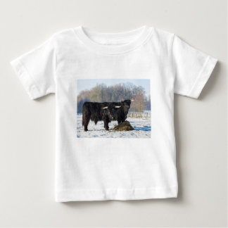 Two black scottish highlanders in winter snow baby T-Shirt