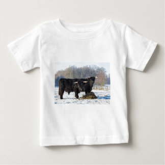 Two black scottish highlanders in winter snow baby T-Shirt