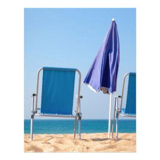 Two blue beach chairs and parasol at sea.JPG Letterhead