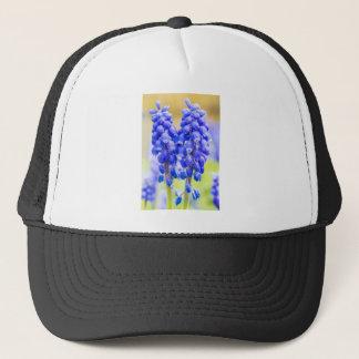 Two blue grape hyacinths in spring trucker hat