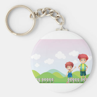 Two boys in the farm basic round button keychain