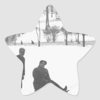 Two Boys Pulling Two Girls on Sleds Star Sticker