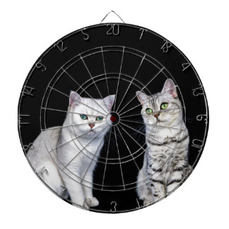 Two british short hair cats on black background dartboard