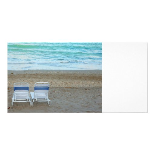 Two chairs on beach sand ocean waves photo card