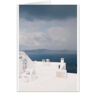 Two chairs on Santorini island Card