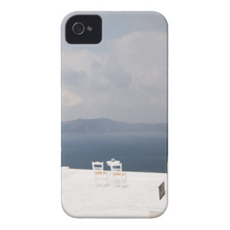 Two chairs on Santorini island iPhone 4 Cover