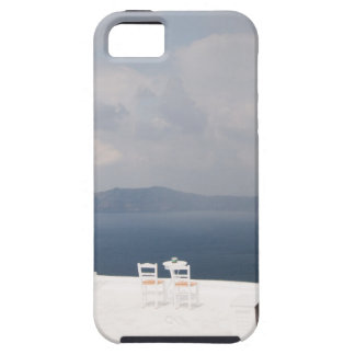 Two chairs on Santorini island iPhone 5 Cover