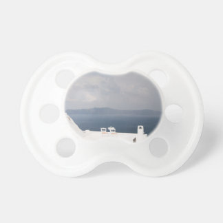 Two chairs on Santorini island Pacifier