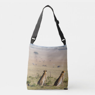 Two cheetahs on the look out crossbody bag