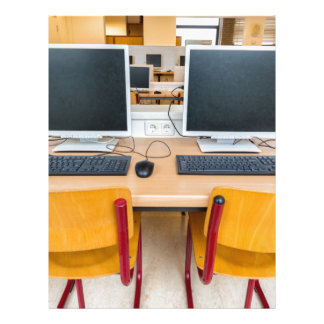 Two computers in classroom on high school letterhead