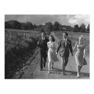 Two couples walking on country road B&W Postcard