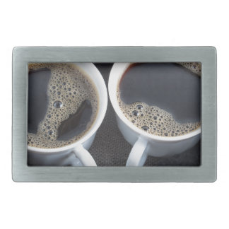 Two cups of coffee wrapped a black wool scarf belt buckles