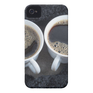 Two cups of coffee wrapped a black wool scarf iPhone 4 cases