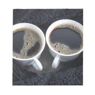 Two cups of coffee wrapped a black wool scarf notepad