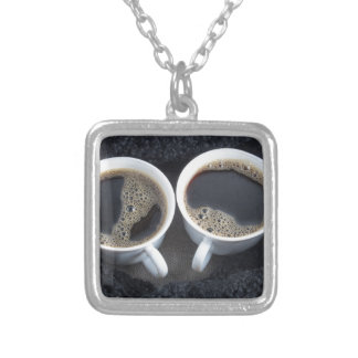 Two cups of coffee wrapped a black wool scarf silver plated necklace