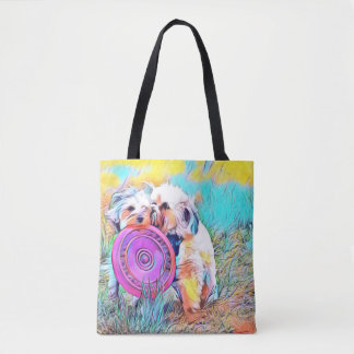 Two cute dogs playing frisbee tote