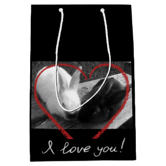 Two cute rabbits with a heart. Opposites attract Medium Gift Bag