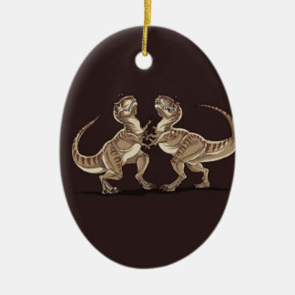 Two dinosaurs fighting each other illustration ceramic oval ornament
