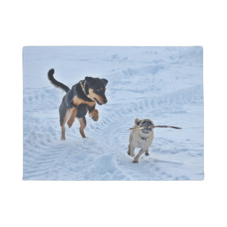 Two Dogs Playing In The Snow Door Mat