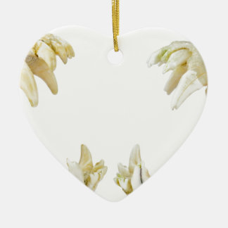 Two dogs skulls with open mouths ceramic heart ornament